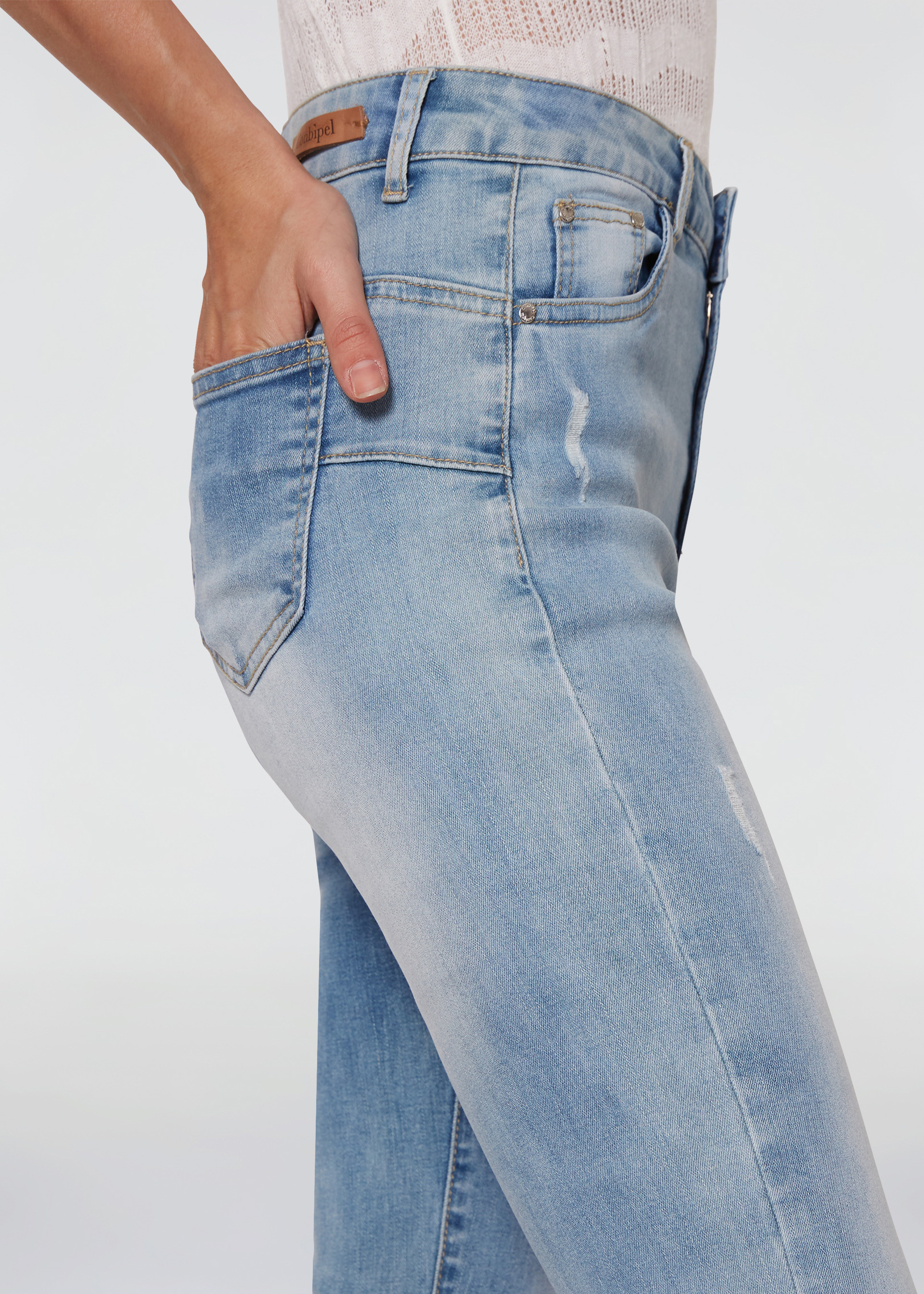 Jeans skinny con rotture